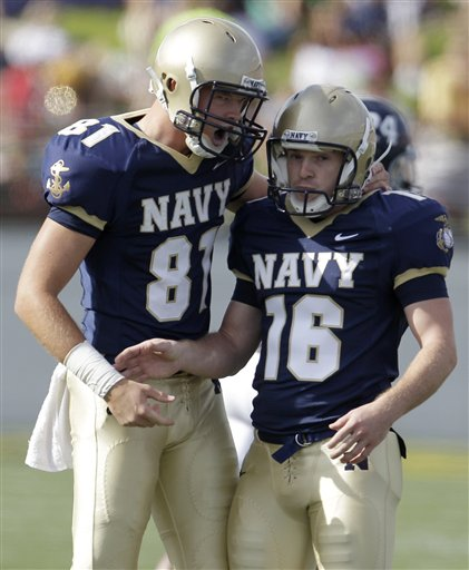 Navy's Justin Haan (81) celebrates with kicker Joe Buckley after his second field goal in the first half. (AP Photo/Rob Carr)