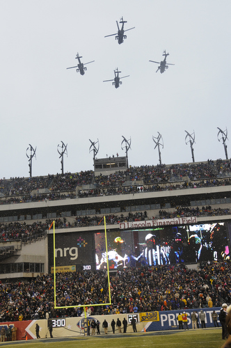 Army Apache helicopters fly over Lincoln Financial Field in Philadelphia, Pa., on Saturday, December 14, 2013 before the start of the 114th Army-Navy football game. (Mike Morones/Staff)