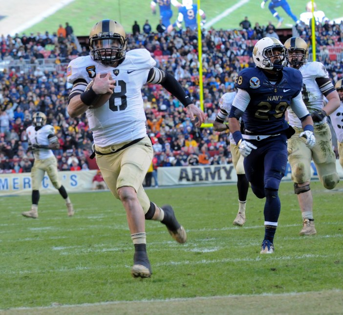 Trent Steelman scores on a second-quarter scamper during the 2011 Army-Navy game at FedEx Field outside Washington, D.C. Steelman hopes to suit up for the Baltimore Ravens  this season (Staff photo by Alan Lessig)