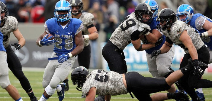 Air Force running back Jacobi OwensNov 1, 2014; West Point, NY, USA; Air Force Falcons running back Jacobi Owens, here heading upfield against Army West Point in 2014, will start at tailback for the Falcons on Saturday against the Black Knights. Owens had a team-best 137 yards in last week's win over Hawaii. (USA Today Sports photo by Danny Wild)