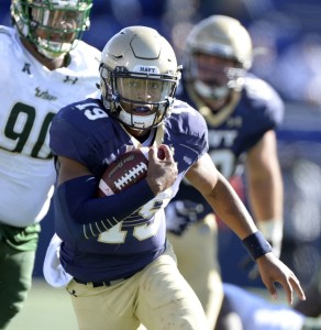 Navy quarterback Keenan Reynolds heads for daylight during the fourth quarter of Saturday's win over South Florida. (USA Today Sports photo by Tommy Gilligan)