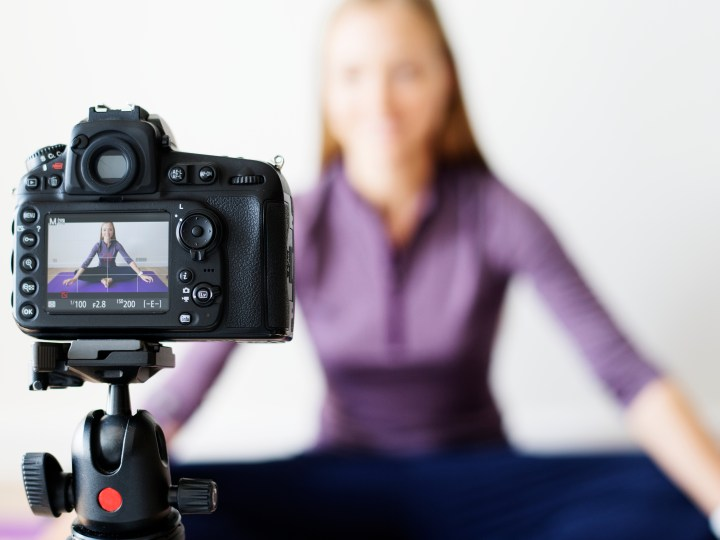 Woman on camera in yoga pose