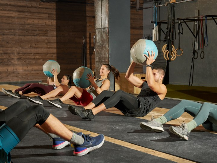 Group workout in CrossFit gym