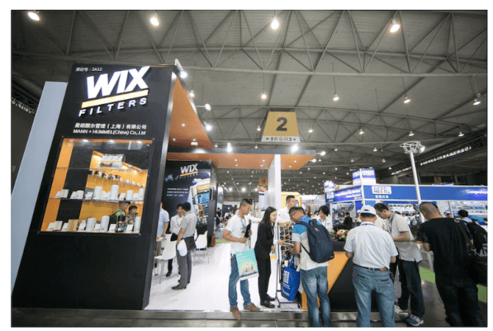 This image shows the WIX Filters booth at the CAPAS auto show in Chengdu. People are looking at auto parts in a booth.
