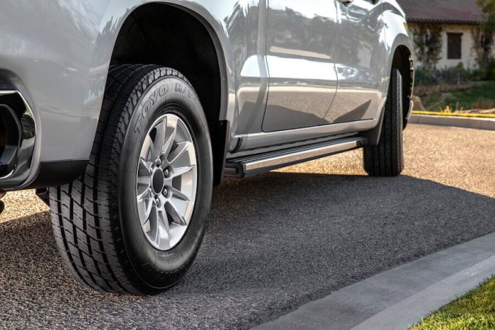 This image shows a close-up of the all-new Toyo Open Country H/T II tire on a silver-colored truck.