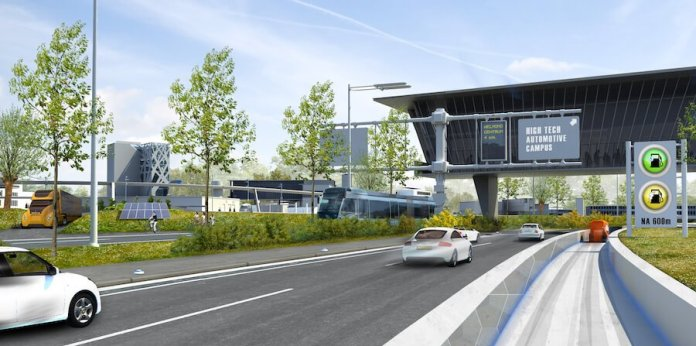 """This photo shows a computer-generated image of cars moving along an intelligent highway. A sign in the photo says, """"high tech automotive campus."""""""