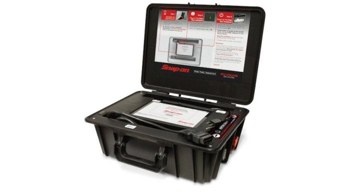 This image shows the Snap-on Pass Through Assistant in its case. The case is black with its lid open. On the lid are instructions to show how to use the device.