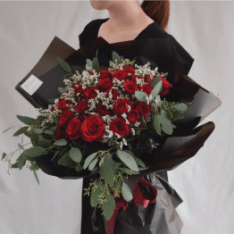 Red Roses Mix with Eucalyptus Leaf & Caspia wrapped in Black Paper