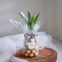 A bottle of Uinah Ginger Beer with Ferrero Rocher chocolates styled in a pineapple shape by AFTERRAINFLORIST
