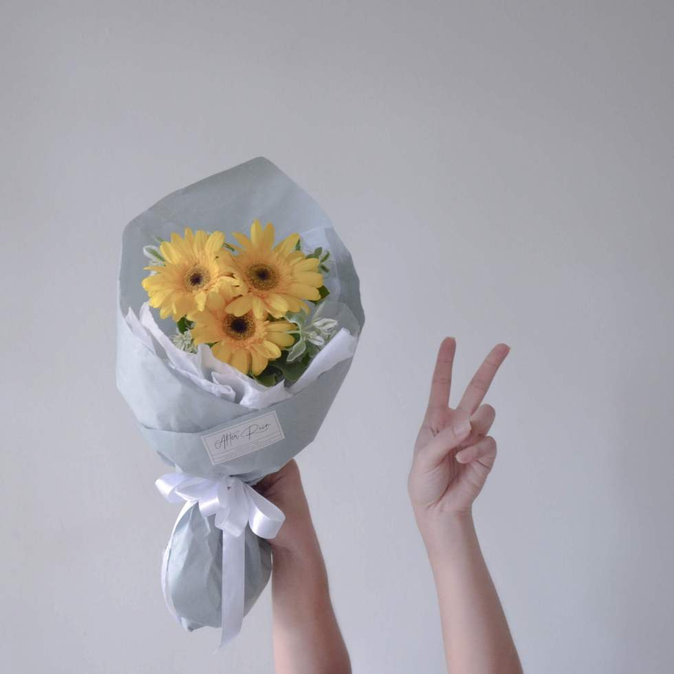 Yellow Gerbera with Variegated Euphorbia Marginata Leaf by AFTERRAINFLORIST