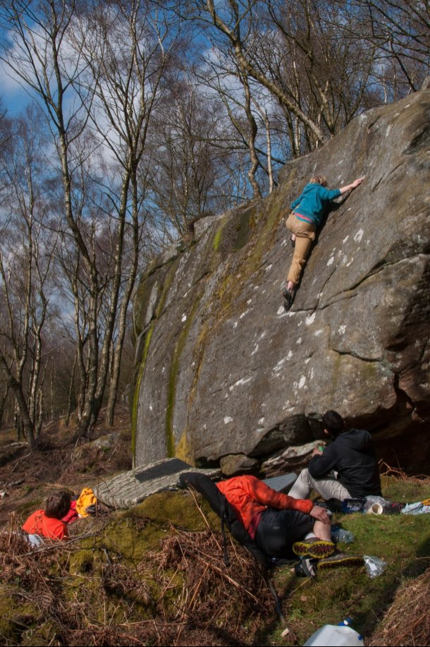 Tom getting his feet high on the mossy slab at Sunset Boulders