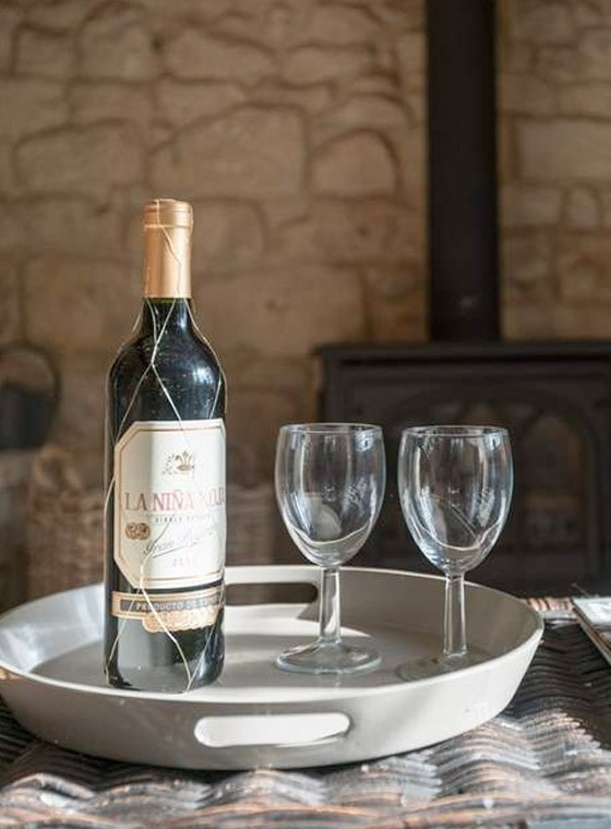 Wine by fire at holiday home in bath