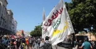 """لافتة تحمل عبارة """"مقاطعون"""" خلال مسيرة فلسطين التي دعا لها """"البيجيدي"""""""