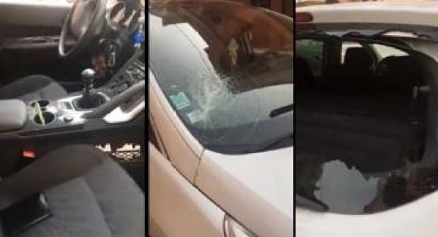 شاهد كيف اعتدى مشرملون على مهاجر مغربي وكسر سيارته.