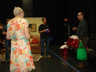 Director Jeff Davis (R) gives the cast and crew a pre-show pep talk. Photo by Jeff Knoll.