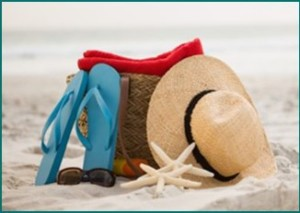 picture of hat and bag on a sandy beach