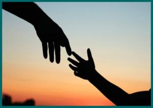 Parent hand touching Child's hand