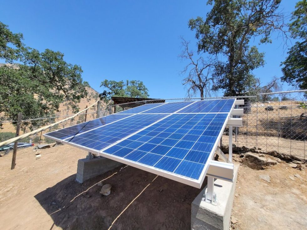 Aims Power 275 watt solar panels on ground mount rack with concrete footings