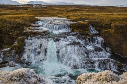 Only a few steps downstream from Fosslaug hot pot is this gorgeous waterfall named Reykjafoss.