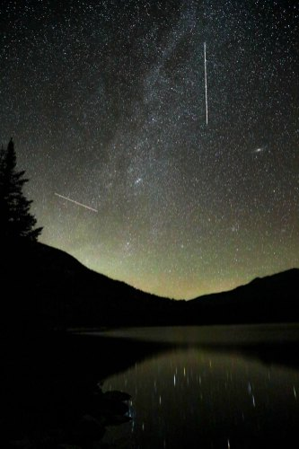 A meteor shower over Lonesome Lake in the White Mountains on a clear, warm night!