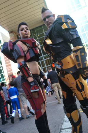 Rachelle Martins (left) and Lee Stewart (right) stand up tall at Comicon in downtown Phoenix Saturday afternoon.