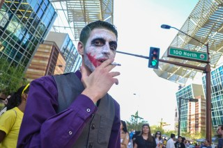 Cody Nowicki smokes a cigarette at Comicon in downtown Phoenix Saturday afternoon.