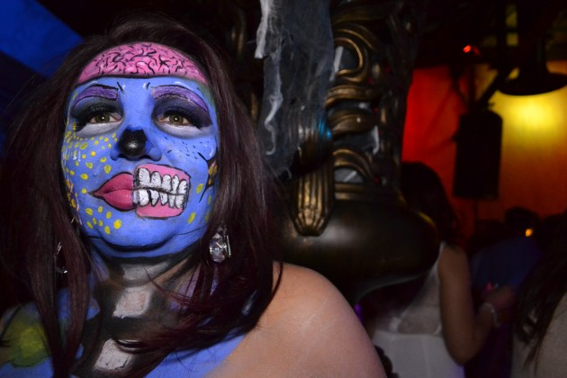 A zombie is not camera shy during the Zombie Ball event at Club Palazzo in Phoenix, Arizona on October 16, 2015.