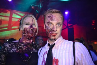 Zombies pose for pictures during the Zombie Ball event at Club Palazzo in Phoenix, Arizona on October 16, 2015