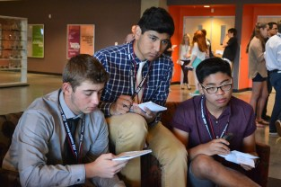 Daniel Gorman (left), Miguel Montanez (middle) and John Gimenez (right) take notes and listen while doing an interview excercise during the Summer Journalism Program on June 4, 2015.
