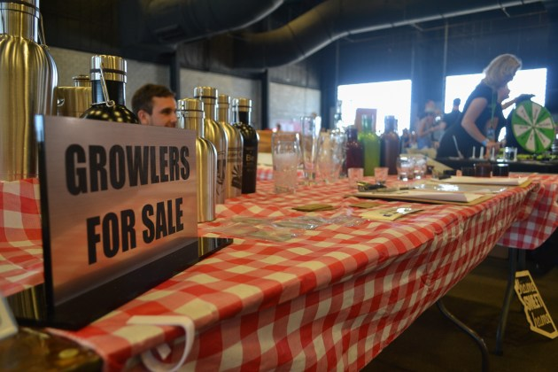 Different Growlers for sale shown at the Scottsdale Beer Palooza on June 20, 2015.