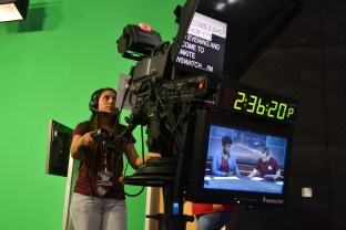 Jennifer Sierra prepares her camera shot before doing a runthrough during the Summer Journalism Program on June 3, 2015.