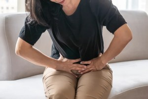 Woman suffering from pelvic pain