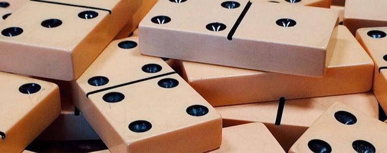 An image of fallen dominoes.