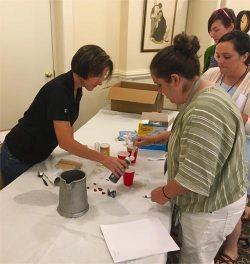 SCRUB Lab: Kris Hiney distributes mock diseases for biosecurity workshop