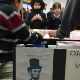 """One of many adorable Abe Lincoln impersonators. Four students chose to study """"Honest Abe,"""" an Illinois hero who helped establish our nation's commitment to human rights, a critical dialog now two hundred years in the making. It is important that our students understand the milestones of past and present as they start to define what their impact will be."""