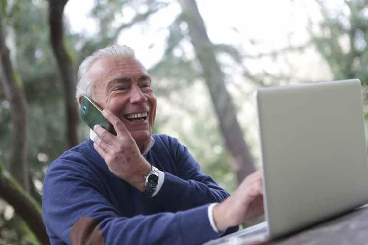 a man in wearing long sleeve shirt using digital gadgets