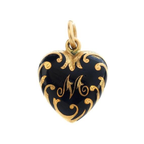 A mid Victorian gold enamel heart locket.