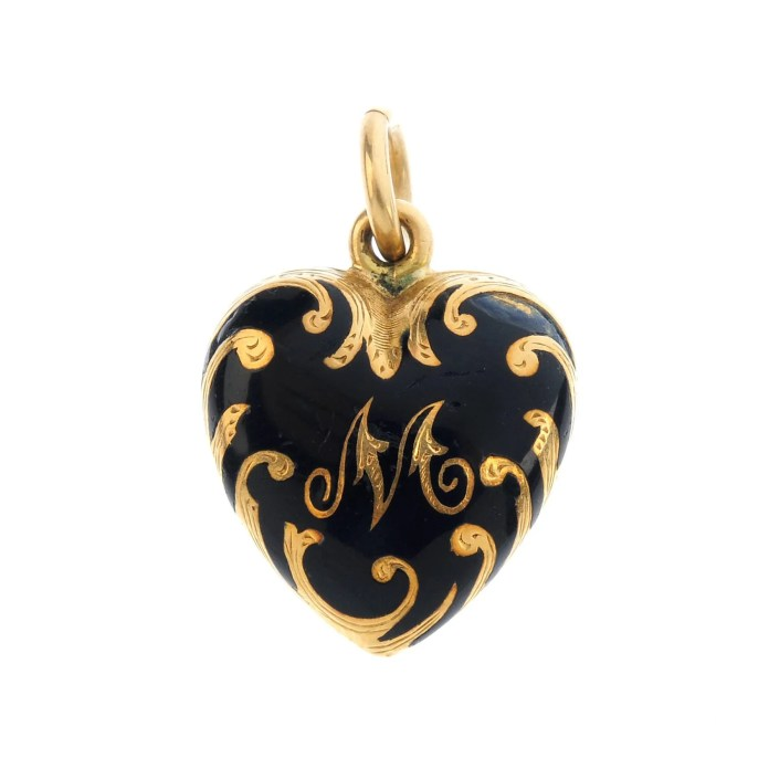 A mid Victorian gold enamel heart locket.
