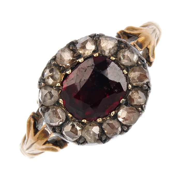 A late Georgian gold, garnet and diamond cluster ring.