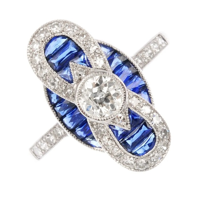 A sapphire and diamond dress ring.