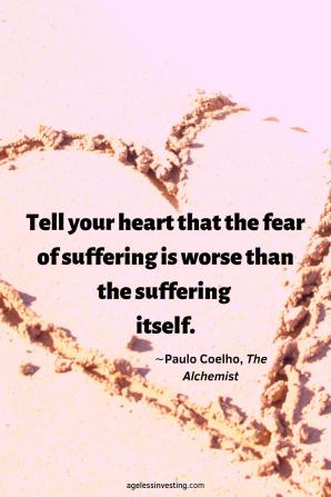 """A heart drawn in the sand with a quote inside the heart, """"Tell your heart that the fear of suffering is worse than the suffering itself""""∼Paulo Coelho"""