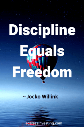 """A hot air balloon hovering over water at night, headline quote """"Discipline Equals Freedom"""" -Jocko Willink"""
