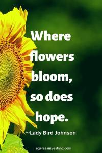 """A Sunflower against a green background, quote """"Where flowers bloom, so does hope."""" -Lady Bird Johnson"""
