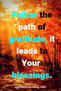 """Sunlight shining through fall leaves, quote """"Follow the path of gratitude, it leads to your blessings"""" -agelessinvesting.com"""