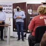 Leo Nardini y Sandro Ortega brindaron un sentido reconocimiento a los compañeros agentes de Defensa Civil de Malvinas Argentinas