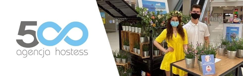 hostessa i host na targach kwiatów i roślin