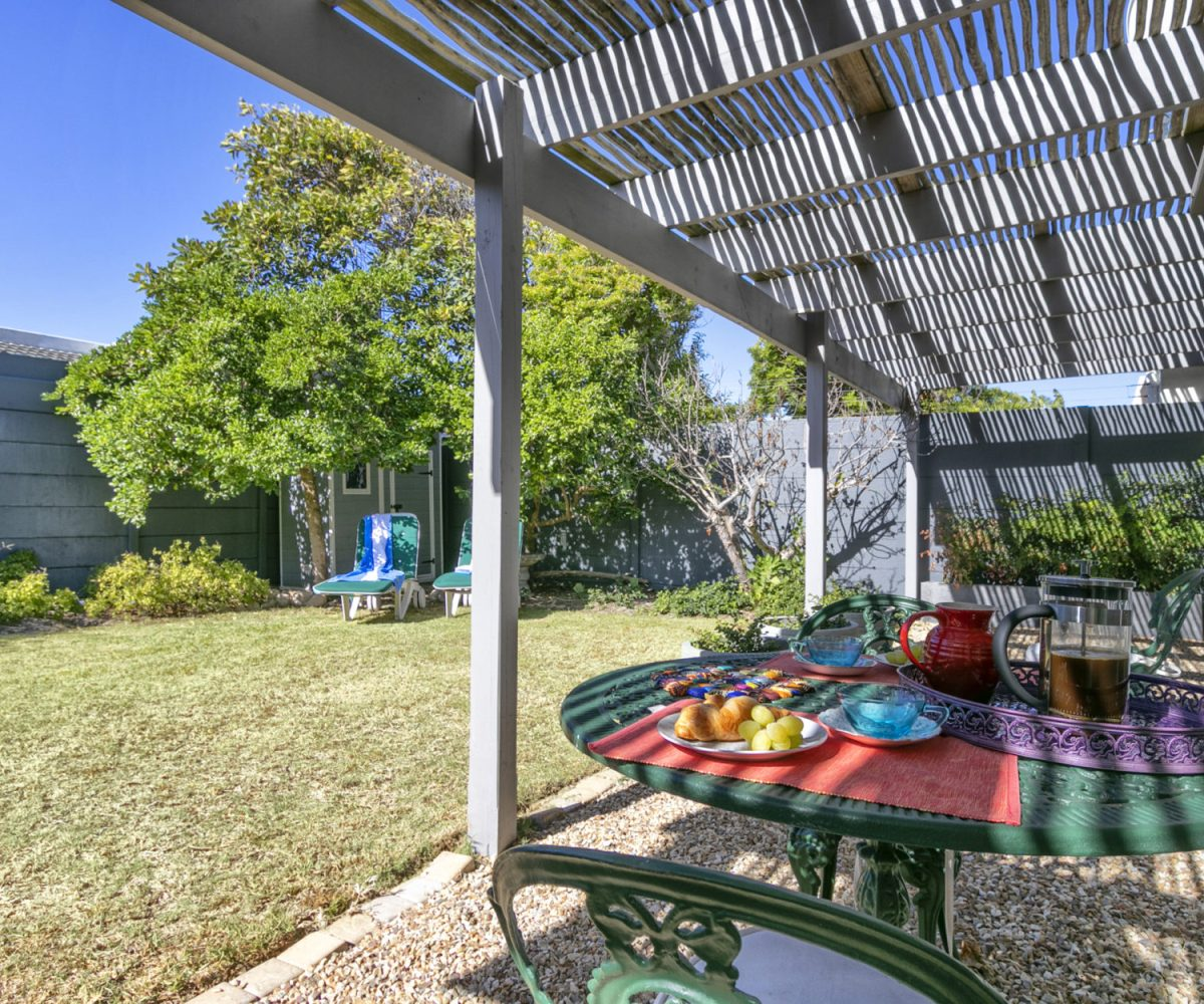 Lawn at 2 Bedroom Marina Da Gama Self Catering Accommodation In Muizenberg - Heron Cottage