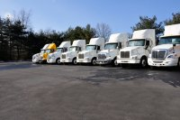 Picture of seven large trucks of the type insured in the Massachusetts commercial auto assigned risk plan