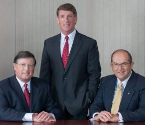 Left to right: Robert W. Gilbert Jr., chairman of the board, John E. Dowd, Jr., president and chief executive officer, David W. Griffin, Sr., executive vice-president and treasurer.