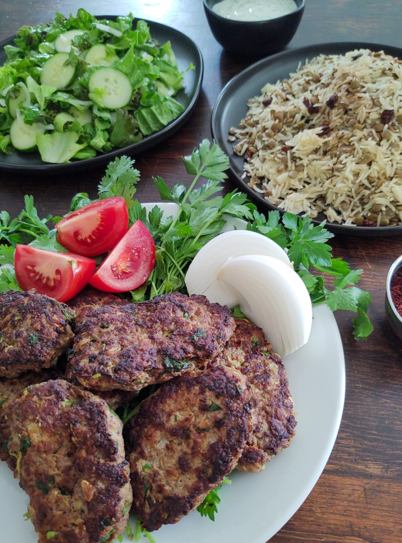 Finished photo of meat patties with rice and salad